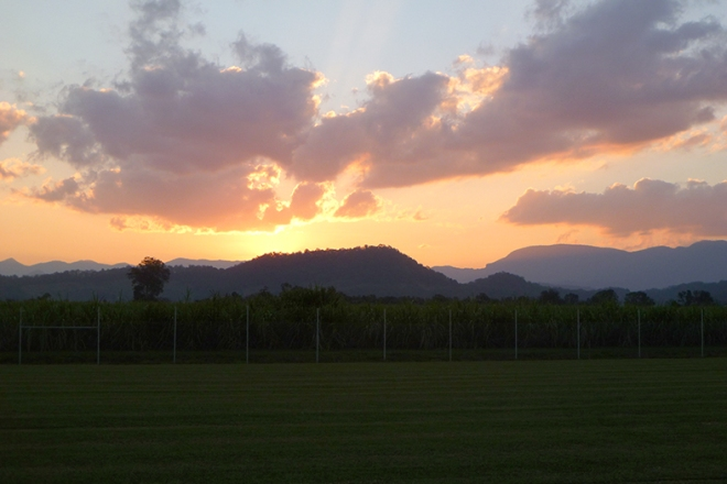Sunset over the Mt Warning range at Murwillumbah. Canefields are