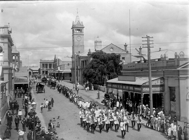 A parade down Gill Street, Charters Towers from Mosman street. c